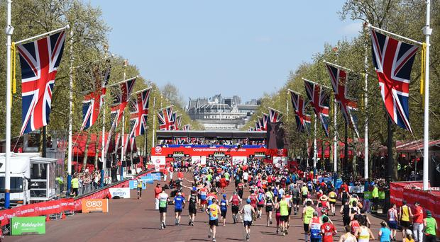 Runners make their way along The Mall towards finish line (PA)