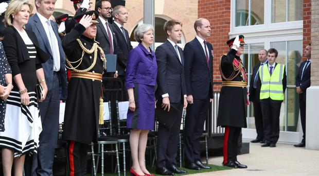 Theresa May, the Duke of Westminster and the Duke of Cambridge attend the official handover of the Defence and National Rehabilitation Centre (Danny Lawson/PA)