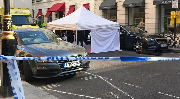 Emergency services at the corner of Dover Street and Albemarle Street in Mayfair after a man collapsed in the street (Tess De La Mare/PA)