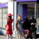 Racegoers at the scene of the incident where it is understood that four horses and a carriage crashed into the window of a clothes shop (David Mirzoeff/PA)