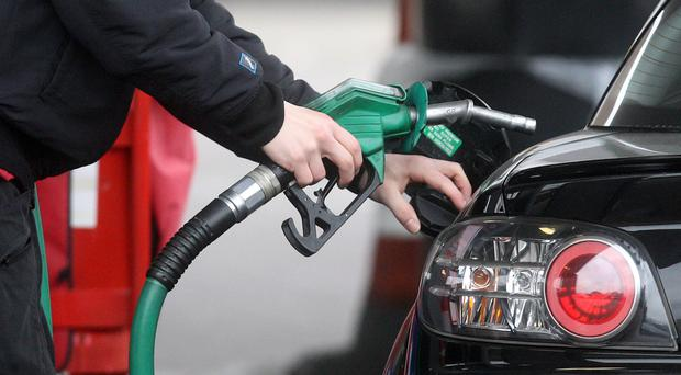 Three supermarkets will cut fuel prices. (Lewis Whyld/PA)