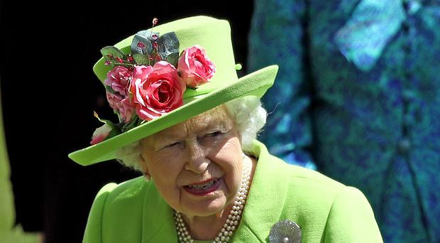 The Queen arrives for day four of Royal Ascot in a green hat. (Steve Parsons/PA)