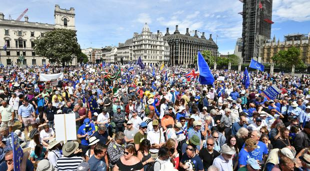 Crowds arrive in Parliament Square in central London, during the People's Vote march for a referendum on the terms of the Brexit deal (John Stillwell/PA)