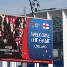 An advertising board welcomes fans to the Nizhny Novgorod Stadium (Tim Goode/PA)