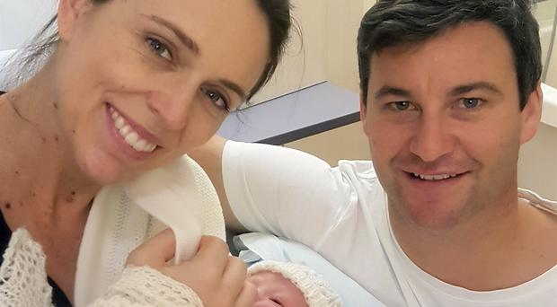 PM Jacinda Ardern and her partner Clarke Gayford pose with their newborn daughter (Office of the Prime Minister of New Zealand/AP)