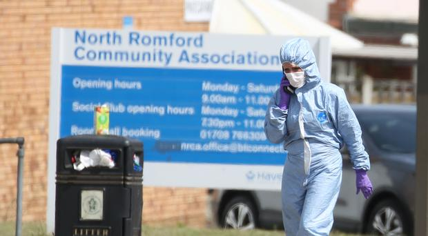 Forensic investigators at the scene of a stabbing in Romford (Isabel Infantes/PA)