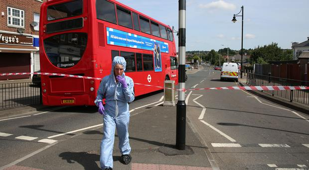 Forensic investigators at the scene of a stabbing in Romford, east London (Isabel Infantes/PA)