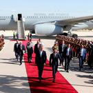 Prince William is greeted at Amman's Marka military airport by Jordanian Crown Prince Hussein bin Abdullah