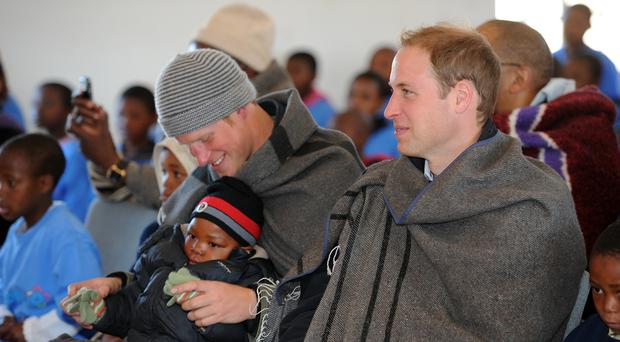 Prince William and Prince Harry visit a children's orphanage in 2010 (Anthony Devlin/PA)