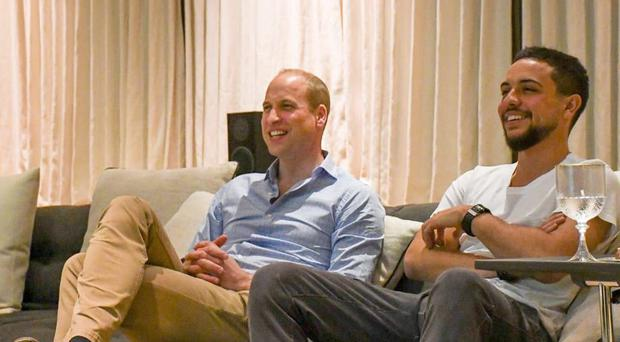 A picture taken from the Kensington Palace Twitter feed showing the Duke of Cambridge watching a rerun of the England v Panama game with the Crown Prince of Jordan (Kensington Palace/Twitter)