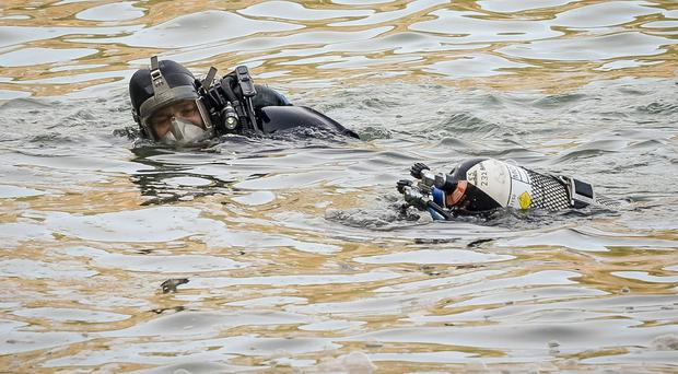 Police divers (Ben Birchall/PA)