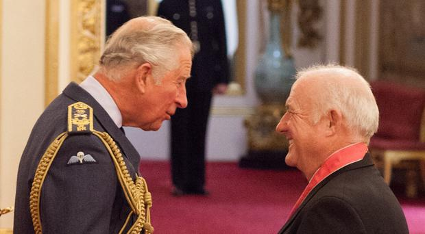 Chef Rick Stein is presented with a CBE by the Prince of Wales (Dominic Lipinski/PA)