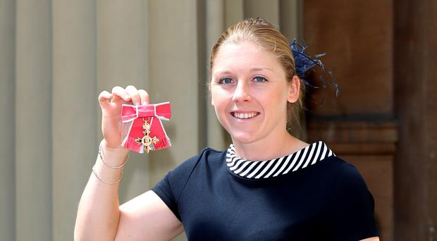 Heather Knight with her award (Steve Parsons/PA)