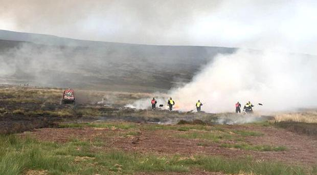 Firefighters battling a blaze on a moor (Derbyshire Fire and Rescue)