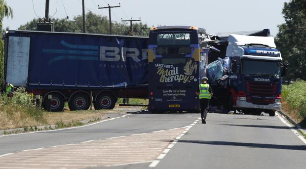 Two men travelling in a double-decker bus died after it collided with a lorry on the A47 at Thorney Toll near Wisbech in Cambridgeshire.