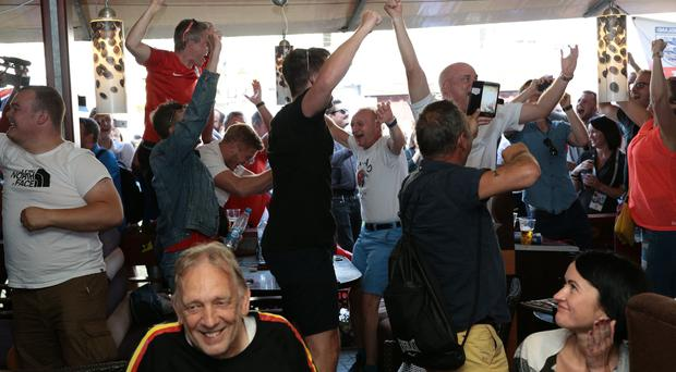 English football fans celebreate in a bar in Kaliningrad after Germany were knocked (Aaron Chown/PA)