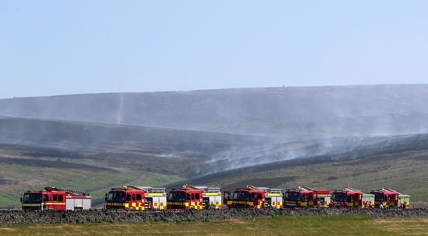 Firefighters tackle a wildfire on Saddleworth Moor (Danny Lawson/PA)