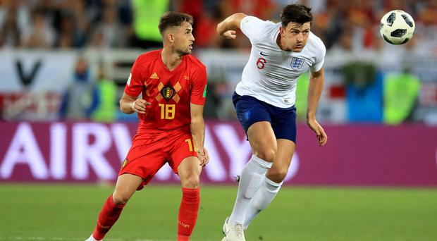 Belgium's Adnan Januzaj, left, and England's Harry Maguire battle for the ball (Adam Davy/PA)