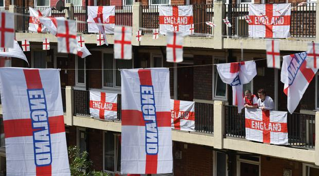 England flags festoon the Kirby Estate in London. (Victoria Jones/PA)