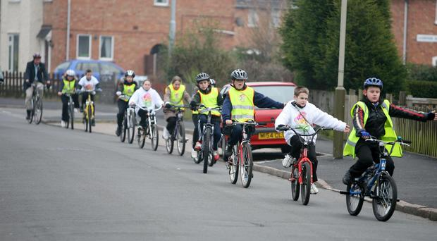 Transport minister Tom Harris MP follows a group of cyclists in Leicester at the launch of Bikeability, a national cycling scheme to get children back on their bikes (Fabio De Paola/PA)