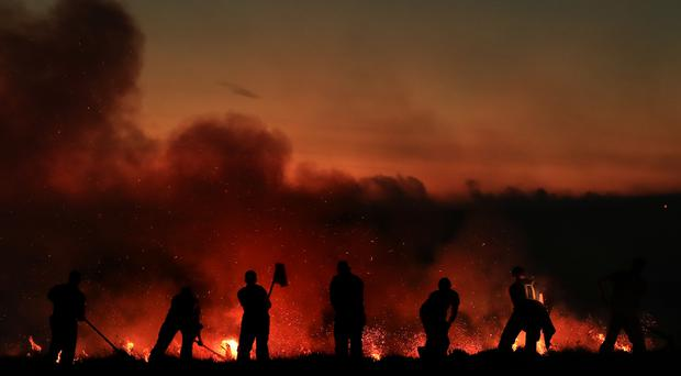 Firefighters tackle a wildfire on Winter Hill near Bolton (Danny Lawson/PA)