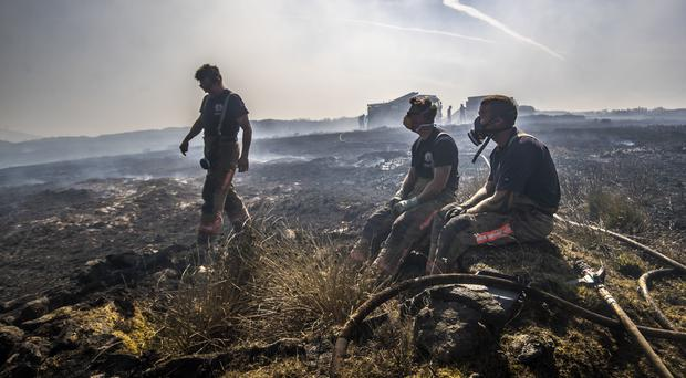 Firefighters tackle the wildfire on Saddleworth Moor (Danny Lawson/PA)