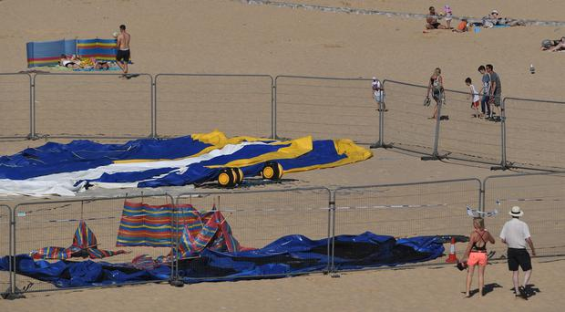 The scene on Gorleston beach in Norfolk, after a young girl died after reportedly being thrown from a bouncy castle (Joe Giddens/PA)