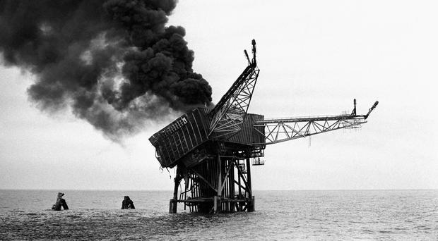The Piper Alpha oil platform the day after it exploded (David Giles/PA)
