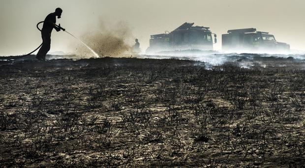 Firefighters tackle a wildfire (Danny Lawson/PA)