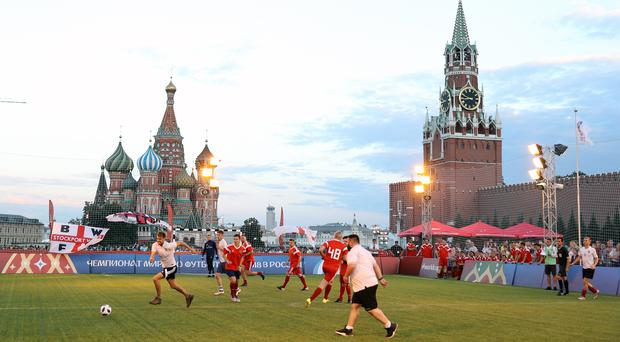 Fans from England and Russia take part in a football match in the fan area of Red Square, Moscow (Owen Humphreys/PA)
