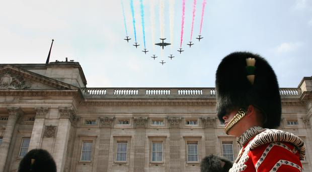 The Red Arrows fly past Buckingham Palace (Chris Young/PA)