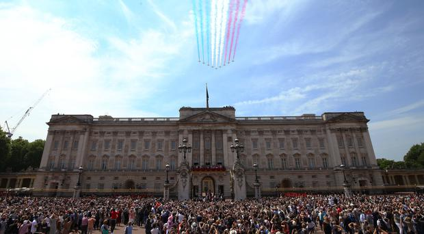RAF Red Arrows during a flypast over Buckingham Palace (Yui Mok/PA)