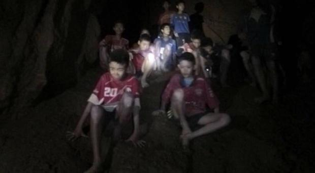 The boys and their coach were found in a partially flooded cave (Tham Luang Rescue Operation Centre via AP)