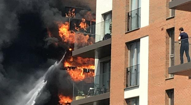 Picture taken with permission from the Twitter feed of @k_leevers of a fire in a block of flats in West Hampstead, London (Kirsten Levermore)