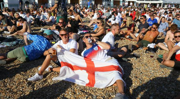 England fans gather on Brighton beach (Gareth Fuller/PA)