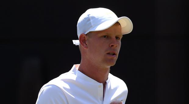 Kyle Edmund in action against Alex Bolt on day two of the Wimbledon Championships (Jonathan Brady/PA)