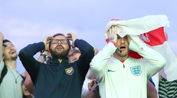 England fans were subjected to an emotional rollercoaster (Gareth Fuller/PA)