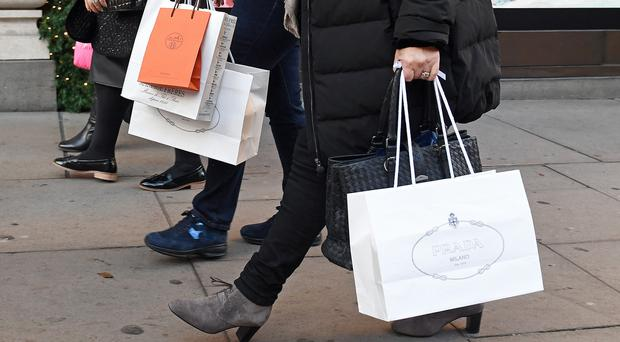 Shoppers with carrier bags (Victoria Jones/PA)
