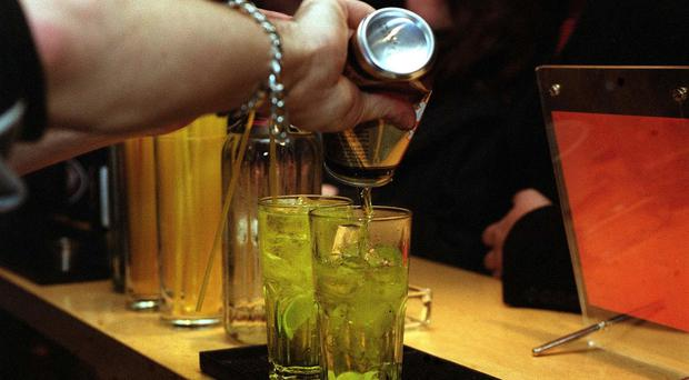 A barman pouring drinks (Michael walter/PA)