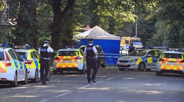Police activity in Belle Vale Road in Liverpool where a 16-year-old boy was stabbed to death (Peter Byrne/PA)