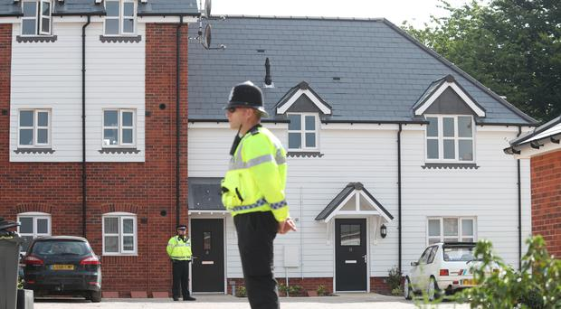 Police activity outside a block of flats on Muggleton Road in Amesbury, Wiltshire (Yui Mok/PA)