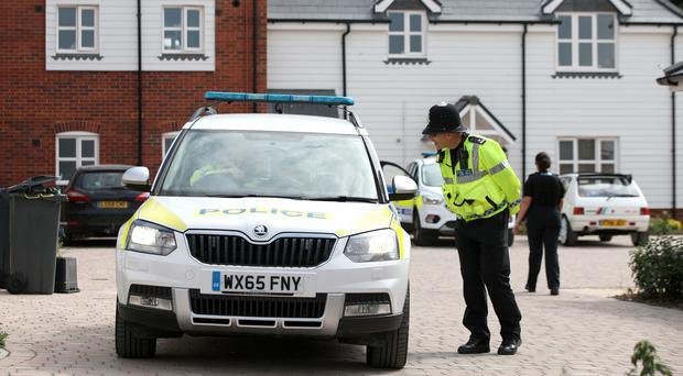 Police activity outside a block of flats on Muggleton Road (Yui Mok/PA)
