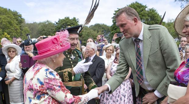 The Queen meets former Scotland ruby player Doddie Weir (Jane Barlow/PA)