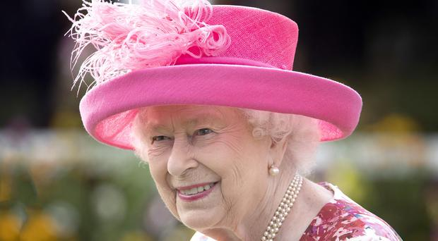 The Queen during a garden party at the Palace of Holyroodhouse in Edinburgh (Jane Barlow/PA)