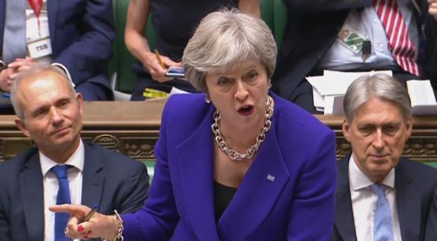 Theresa May reiterated at Prime Minister's Questions that the UK would be leaving the customs union and the single market (PA)