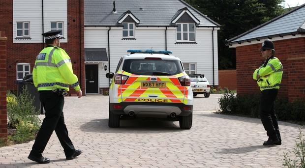 Police activity outside a block of flats on Muggleton Road in Amesbury (Yui Mok/PA)
