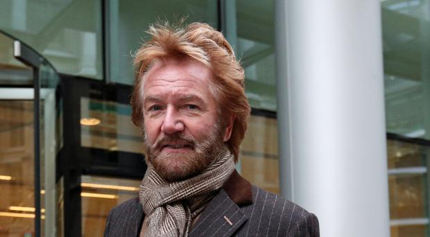 Noel Edmonds is deciding on when to file court papers against Lloyds over HBOS Reading (PA)