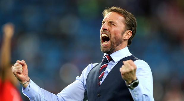 England manager Gareth Southgate celebrates his team's victory over Colombia at the World Cup (Owen Humphreys/PA)