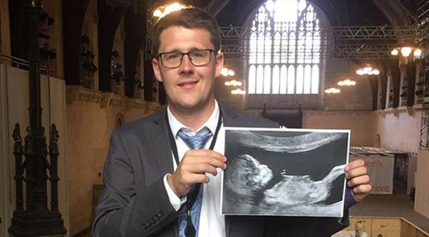 SNP MP David Linden with the scan of his unborn daughter which he held up in the House of Commons chamber (Handout image/PA)