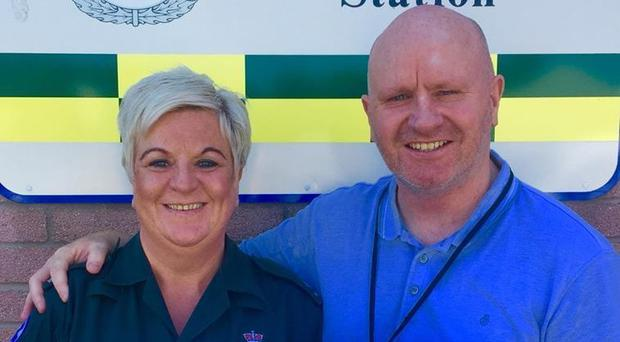 Stef Shaw is reunited with Suzy Hope, the paramedic who saved his life after he was stabbed 12 years ago (Scottish Ambulance Service/PA)
